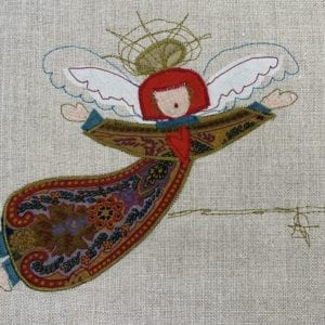 Angel: paisley robe on natural linen