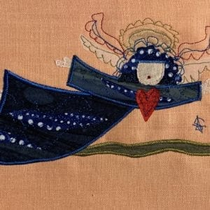 Angel: deep blue robe on peach linen