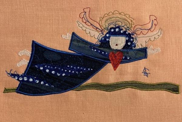 Angel: deep blue robe on peach linen