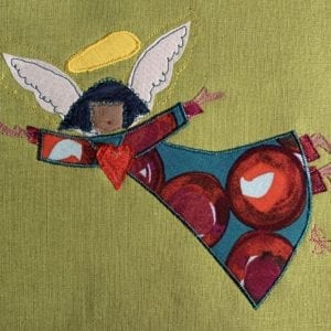 Angel: red bauble robe on pea green linen