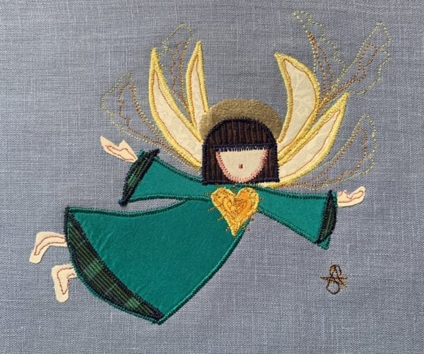 Angel: bottle green robe on French blue linen