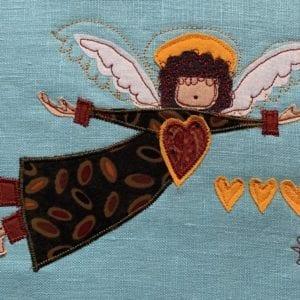 Angel: olive & bean robe on turquoise linen