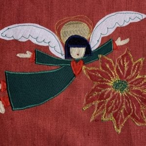 Angel: green robe on red linen with poinsettia