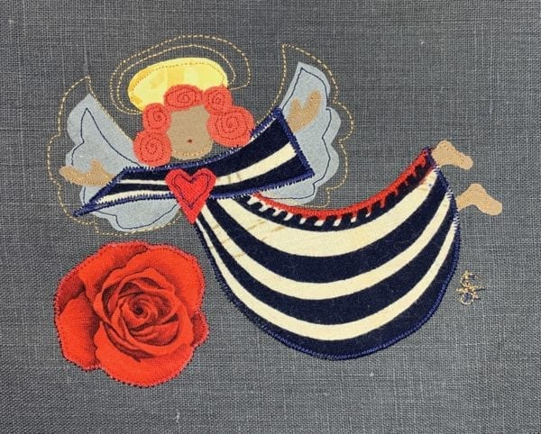 Angel: navy & white stripe robe on slate linen with big rose