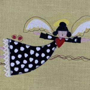 Angel: black & white dot robe on butter yellow linen